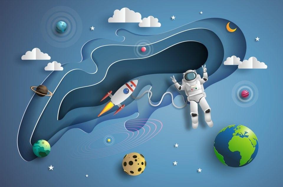 Rakieta, kosmonauta i planety w stylu wycinanki z papieru